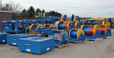 Winches lined up in the yard