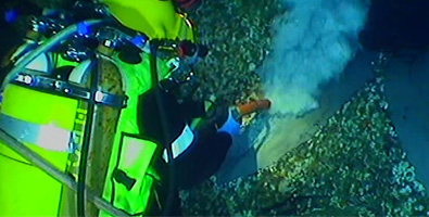 Diver using coating removal equipment
